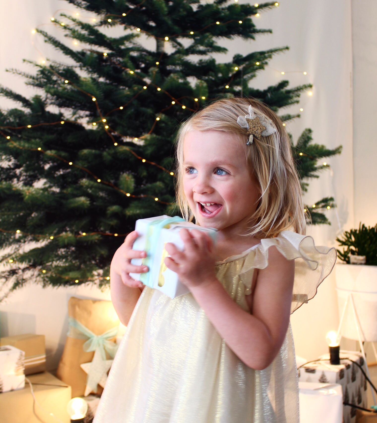 Indi in her beautiful christmas dress by eye story | fashion for toddlers we love | on the blog www.fourcheekymonkeys.com